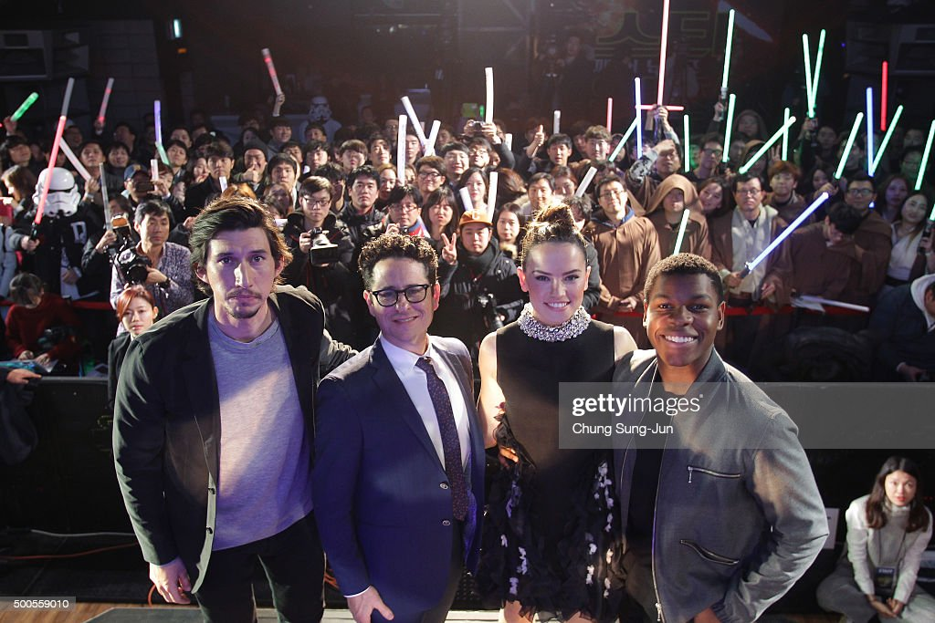 Actor Adam Driver director JJ Abrams actress Daisy Ridley and actor John Boyega attend the event for fans ahead of 'Star Wars The Force Awakens'...