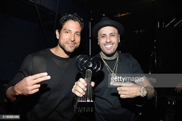Actor Adam Rodriguez and recording artist Nicky Jam winner of 'Latin Song of the Year' for 'El Perdon' backstage at the iHeartRadio Music Awards...