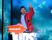 Actor Adam Sandler accepts the Favorite Animated Movie award for 'Hotel Transylvania 2' onstage during Nickelodeon's 2016 Kids' Choice Awards at The...