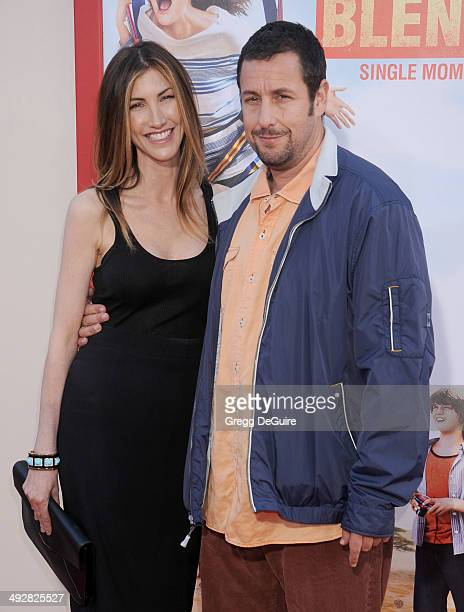 Actor Adam Sandler and Jackie Sandler arrive at the Los Angeles premiere of 'Blended' at TCL Chinese Theatre on May 21 2014 in Hollywood California