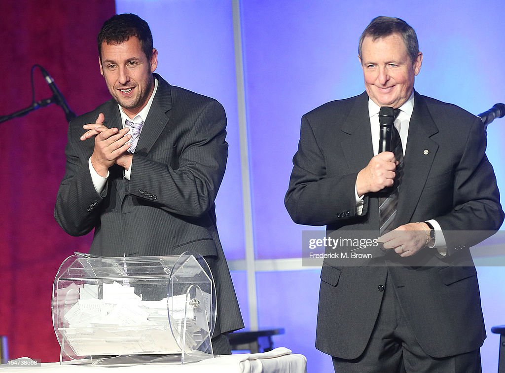 Actor <a gi-track='captionPersonalityLinkClicked' href=/galleries/search?phrase=Adam+Sandler&family=editorial&specificpeople=202205 ng-click='$event.stopPropagation()'>Adam Sandler</a> (L) and <a gi-track='captionPersonalityLinkClicked' href=/galleries/search?phrase=Tom+Sherak&family=editorial&specificpeople=242985 ng-click='$event.stopPropagation()'>Tom Sherak</a> speak during The Fulfillment Fund's STARS 2012 Benefit Gala at The Beverly Hilton Hotel on October 24, 2012 in Beverly Hills, California.