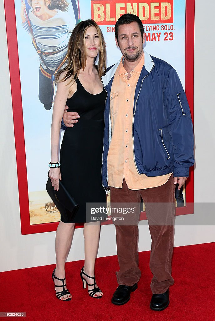 Actor <a gi-track='captionPersonalityLinkClicked' href=/galleries/search?phrase=Adam+Sandler&family=editorial&specificpeople=202205 ng-click='$event.stopPropagation()'>Adam Sandler</a> (R) and wife <a gi-track='captionPersonalityLinkClicked' href=/galleries/search?phrase=Jackie+Sandler&family=editorial&specificpeople=4402496 ng-click='$event.stopPropagation()'>Jackie Sandler</a> attend the Los Angeles premiere of 'Blended' at the TCL Chinese Theatre on May 21, 2014 in Hollywood, California.