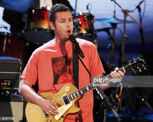 Actor Adam Sandler performs onstage during the 17th Annual MTV Movie Awards held at the Gibson Amphitheatre on June 1 2008 in Universal City...