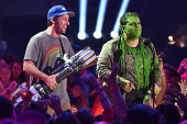 Actor Adam Sandler slimes Josh Gad onstage during Nickelodeon's 28th Annual Kids' Choice Awards held at The Forum on March 28 2015 in Inglewood...
