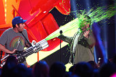 Actor Adam Sandler slimes Josh Gad onstage during the Nickelodeon's 28th Annual Kids' Choice Awards held at The Forum on March 28 2015 in Inglewood...