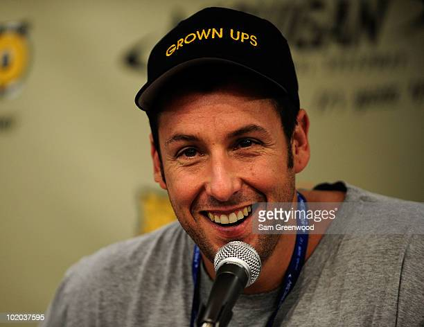 Actor Adam Sandler speaks to the media prior to the NASCAR Sprint Cup Series Heluva Good Sour Cream Dips 400 at Michigan International Speedway on...