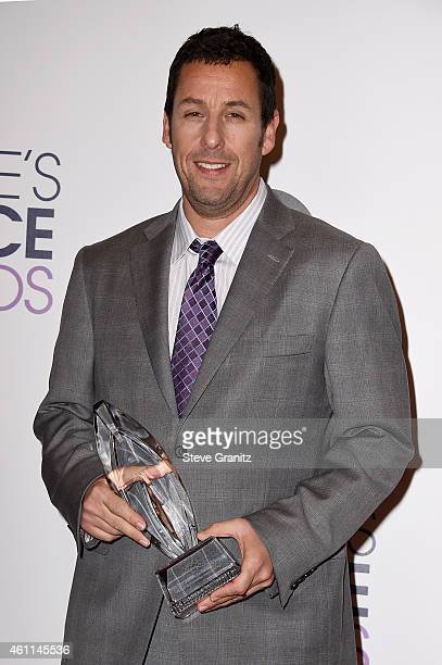 Actor Adam Sandler winner of the Favorite Comedic Movie Actor award poses in the press room at the 41st Annual People's Choice Awards at Nokia...