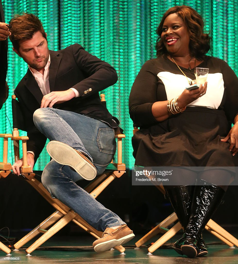 Actor Adam Scott, (L) and actress Retta speak during The Paley Center for Media's PaleyFest 2014 Honoring 'Parks and Recreation' at the Dolby Theatre on March 18, 2014 in Hollywood, California.