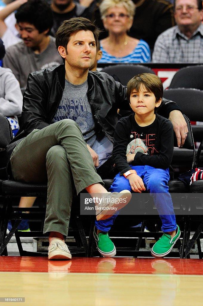 Actor Adam Scott (L) and his son attend the Harlem Globetrotters 'You Write The Rules' 2013 tour game at Staples Center on February 17, 2013 in Los Angeles, California.