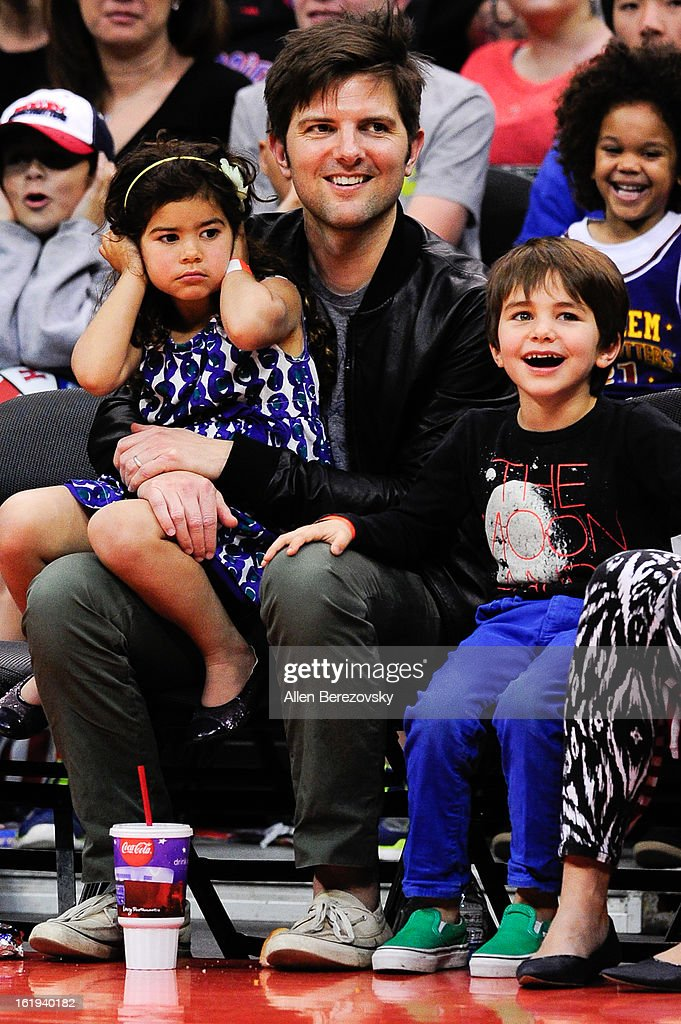 Actor Adam Scott and kids attend the Harlem Globetrotters 'You Write The Rules' 2013 tour game at Staples Center on February 17, 2013 in Los Angeles, California.