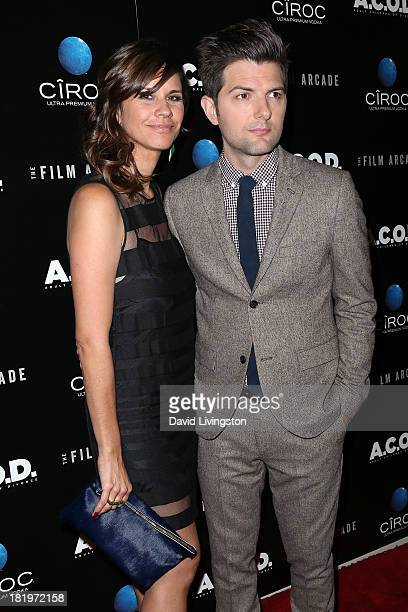 Actor Adam Scott and wife producer Naomi Scott attend the premiere of the Film Arcade's 'ACOD' at the Landmark Theater on September 26 2013 in Los...