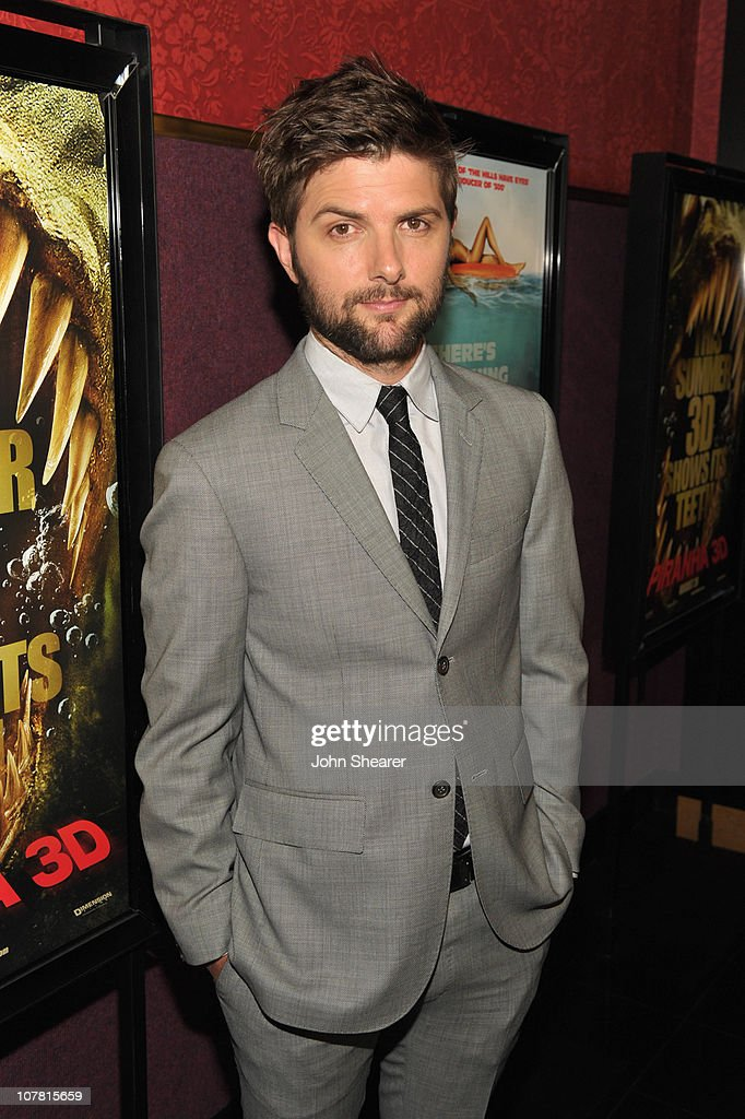 Actor Adam Scott attends the Weinstein Company 'Piranha 3D' premiere at Mann Chinese 6 on August 18, 2010 in Hollywood, California.