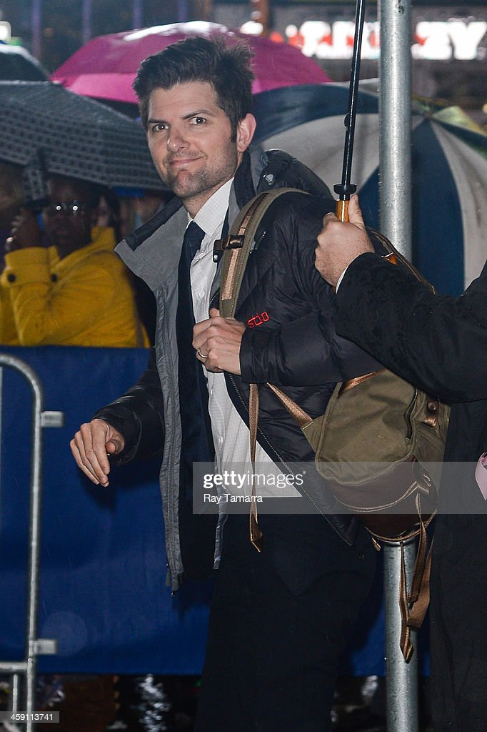 Actor Adam Scott enters the 'Good Morning America' taping at the ABC Times Square Studios on December 23, 2013 in New York City.