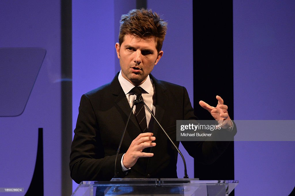 Actor Adam Scott speaks onstage at ELLE's 20th Annual Women In Hollywood Celebration at Four Seasons Hotel Los Angeles at Beverly Hills on October 21, 2013 in Beverly Hills, California.