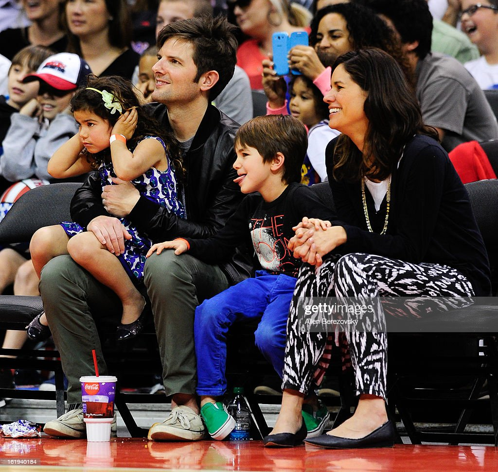 Actor Adam Scott (L), wife Niomi Scott (R) and their children attend the Harlem Globetrotters 'You Write The Rules' 2013 tour game at Staples Center on February 17, 2013 in Los Angeles, California.
