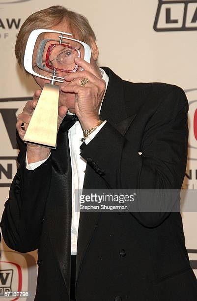 Actor Adam West of 'Batman' poses with the 'Batman 40th Anniversary Award' in the press room at the 2006 TV Land Awards at the Barker Hangar on March...