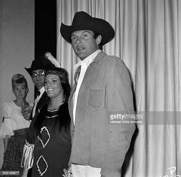 Actor Adam West with Judy Smith attends a costume party in Los AngelesCA