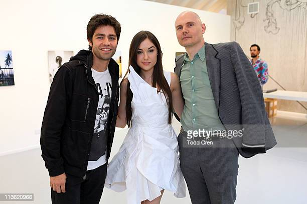 Actor Adrian Grenier actress Sasha Grey and musician Billy Corgan pose at Martha Otero Gallery at her private launch party for her 'Neu Sex' Book on...