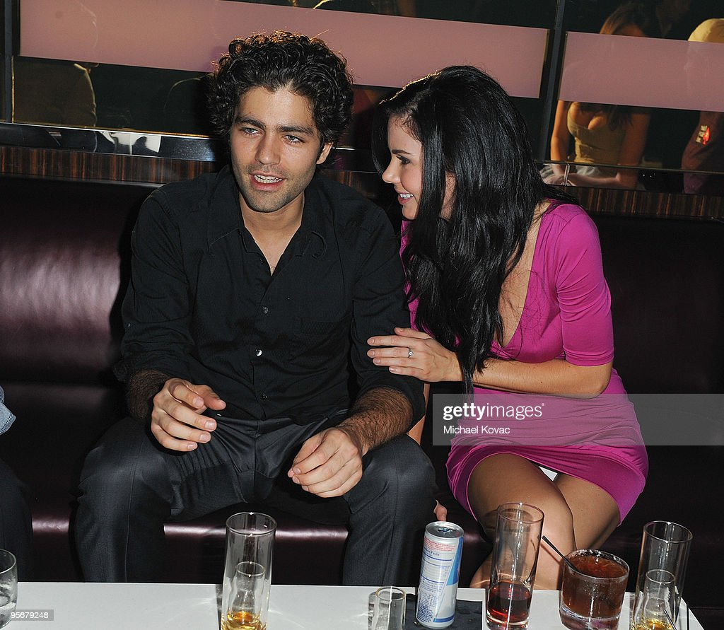 Actor Adrian Grenier (L) and model Jayde Nicole (R) mingle at the amfAR Cocktail Party & PokerStars Red Carpet And Party at Aura Nightclub on January 9, 2010 in Nassau, Bahamas.