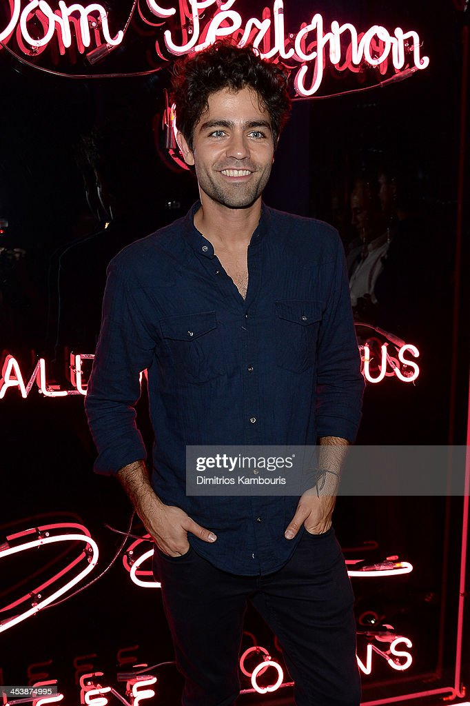 Actor <a gi-track='captionPersonalityLinkClicked' href=/galleries/search?phrase=Adrian+Grenier&family=editorial&specificpeople=211413 ng-click='$event.stopPropagation()'>Adrian Grenier</a> attends Dom Perignon with Alex Dellal, Stavros Niarchos, and Vito Schnabel Present Dom Perignon Limited Edition by Jeff Koons at Wall at W Hotel on December 5, 2013 in Miami Beach, Florida.