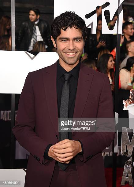 Actor Adrian Grenier attends the 2014 MTV Movie Awards at Nokia Theatre LA Live on April 13 2014 in Los Angeles California