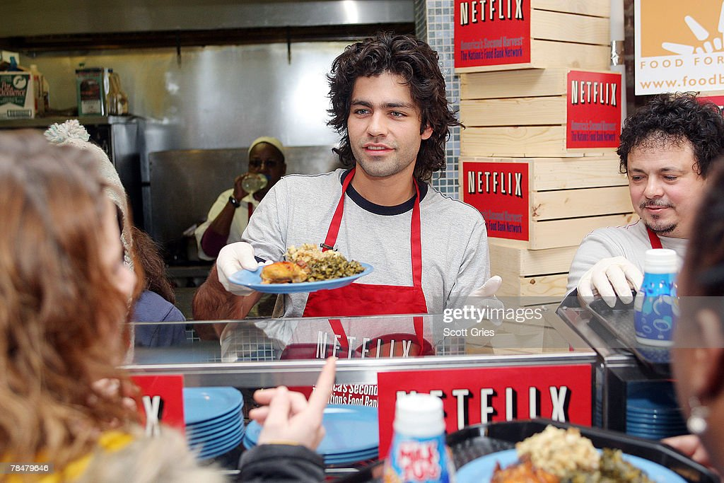 Actor Adrian Grenier helps serve lunch to New Yorkers hosted by Netflix and America's Second Harvest at Neighbors Together Soup Kitchen on December...