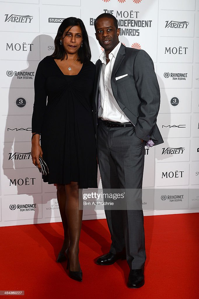 Actor Adrian Lester (R) arrives on the red carpet for the Moet British Independent Film Awards at Old Billingsgate Market on December 8, 2013 in London, England.