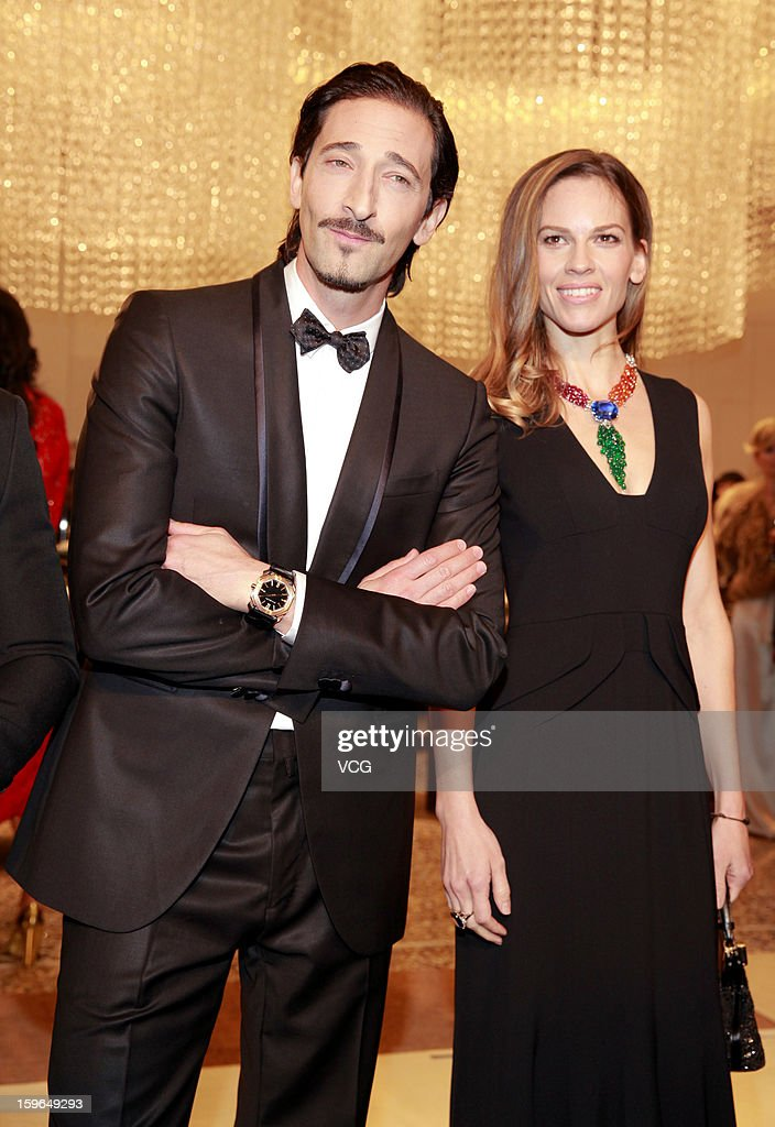 Actor <a gi-track='captionPersonalityLinkClicked' href=/galleries/search?phrase=Adrien+Brody&family=editorial&specificpeople=202175 ng-click='$event.stopPropagation()'>Adrien Brody</a> and actress <a gi-track='captionPersonalityLinkClicked' href=/galleries/search?phrase=Hilary+Swank&family=editorial&specificpeople=201692 ng-click='$event.stopPropagation()'>Hilary Swank</a> attend Bulgari store opening reception on January 17, 2013 in Hong Kong, Hong Kong.