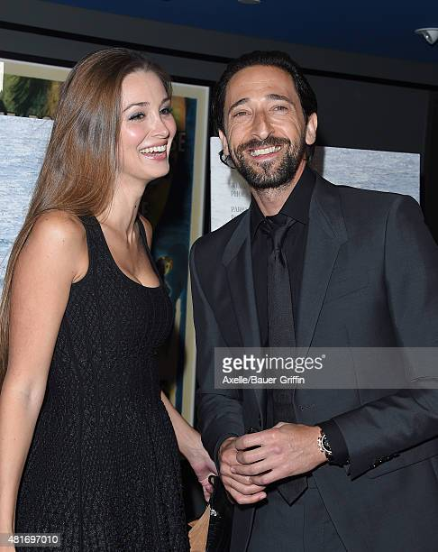 Actor Adrien Brody and Lara Leito arrive at the Los Angeles Premiere of 'Irrational Man' at the Writers Guild Theatre on July 9 2015 in Los Angeles...