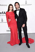 Actor Adrien Brody and Lara Leito attend amfAR's 22nd Cinema Against AIDS Gala Presented By Bold Films And Harry Winston at Hotel du CapEdenRoc on...