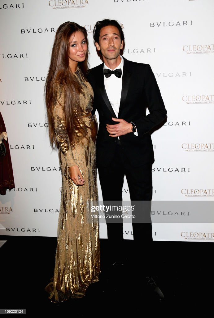 Actor <a gi-track='captionPersonalityLinkClicked' href=/galleries/search?phrase=Adrien+Brody&family=editorial&specificpeople=202175 ng-click='$event.stopPropagation()'>Adrien Brody</a> (R) and Lara Leito attend the 'Cleopatra' cocktail hosted by Bulgari during The 66th Annual Cannes Film Festival at JW Marriott on May 21, 2013 in Cannes, France.