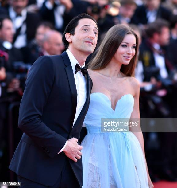 US actor Adrien Brody and Lara Lieto arrive for the screening of the film 'Les Fantomes dIsmael' out of competition and the Opening Ceremony of the...