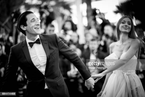 Actor Adrien Brody and Lara Lieto attend the 'Ismael's Ghosts ' screening and Opening Gala during the 70th annual Cannes Film Festival at Palais des...