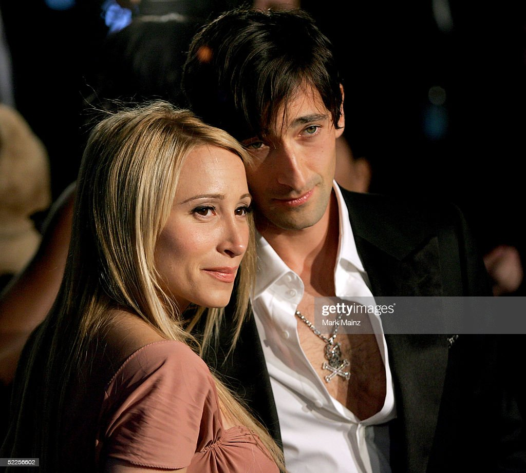 Actor Adrien Brody (R) and Michelle Dupont arrive at the Vanity Fair Oscar Party at Mortons on February 27, 2005 in West Hollywood, California.