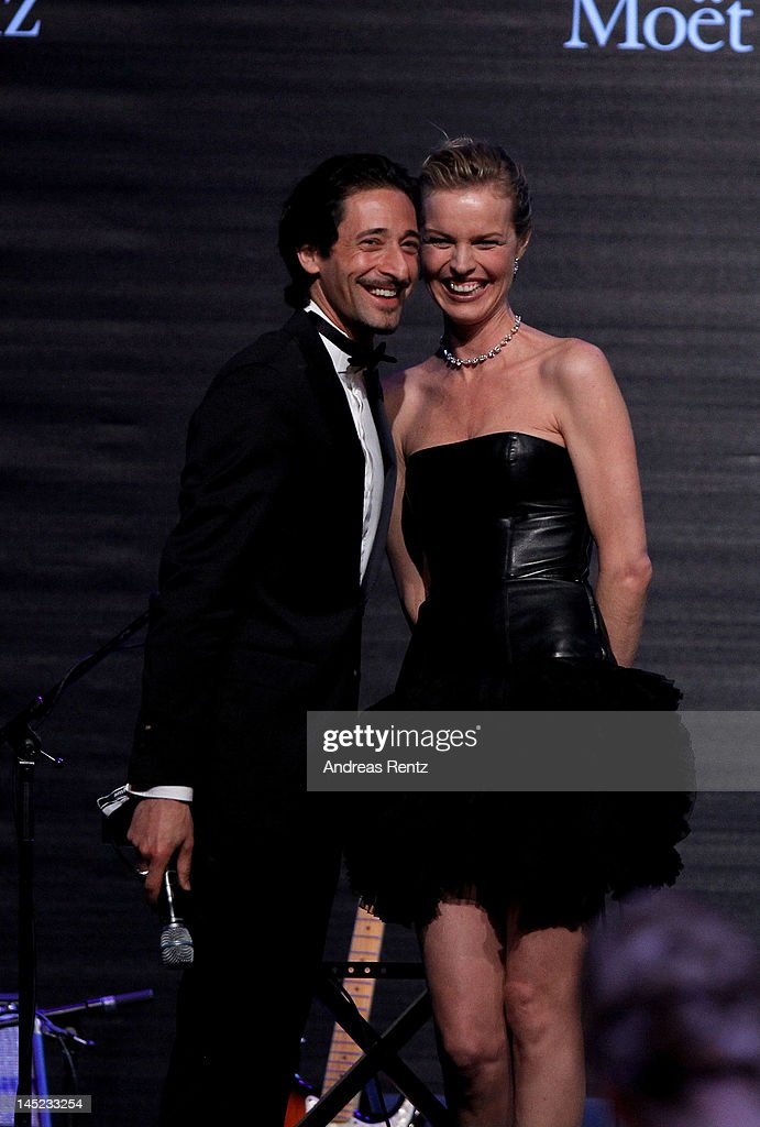 Actor <a gi-track='captionPersonalityLinkClicked' href=/galleries/search?phrase=Adrien+Brody&family=editorial&specificpeople=202175 ng-click='$event.stopPropagation()'>Adrien Brody</a> and model <a gi-track='captionPersonalityLinkClicked' href=/galleries/search?phrase=Eva+Herzigova&family=editorial&specificpeople=156428 ng-click='$event.stopPropagation()'>Eva Herzigova</a> speak onstage during the 2012 amfAR's Cinema Against AIDS during the 65th Annual Cannes Film Festival at Hotel Du Cap on May 24, 2012 in Cap D'Antibes, France.