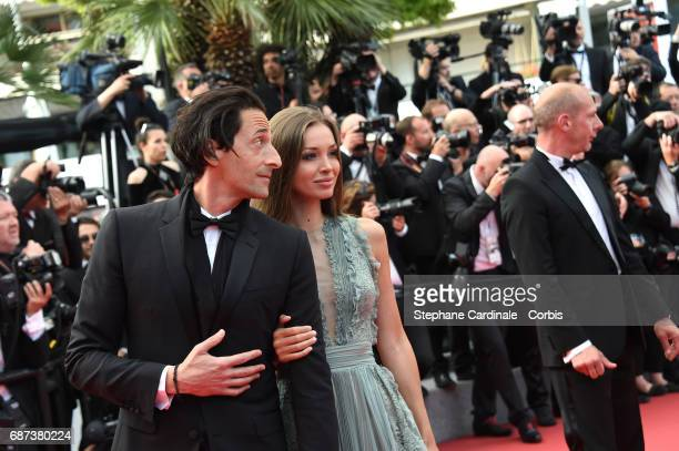 Actor Adrien Brody and model Lara Lieto attend the 70th Anniversary of the 70th annual Cannes Film Festival at Palais des Festivals on May 23 2017 in...