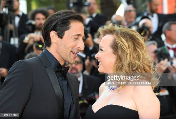 US actor Adrien Brody and the CoPresident of Chopard Caroline Scheufele arrive on May 28 2017 for the closing ceremony of the 70th edition of the...