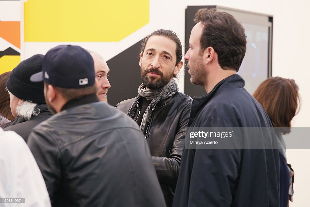 Actor <a gi-track='captionPersonalityLinkClicked' href=/galleries/search?phrase=Adrien+Brody&family=editorial&specificpeople=202175 ng-click='$event.stopPropagation()'>Adrien Brody</a> (C) attends the 2016 Frieze Art Fair: New York at Randall's Island on May 4, 2016 in New York City.