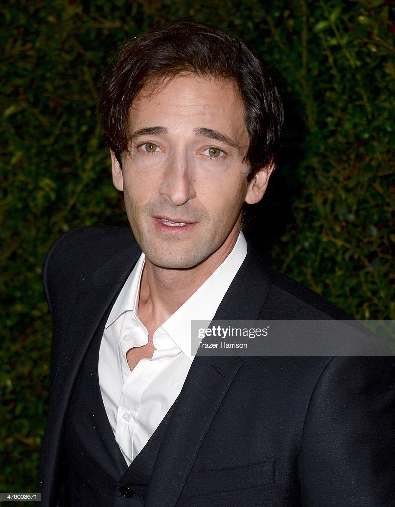 Actor Adrien Brody attends the Chanel and Charles Finch Pre-Oscar Dinner at Madeo Restaurant on March 1, 2014 in Los Angeles, California.