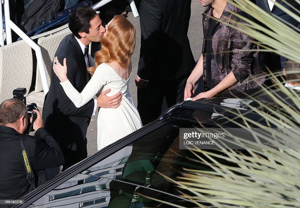 US actor Adrien Brody (L) greets actress Jessica Chastain as she arrives on May 21, 2013 for the screening of the film 'Cleopatra' presented in Cannes Classics at the 66th edition of the Cannes Film Festival in Cannes. Cannes, one of the world's top film festivals, opened on May 15 and will climax on May 26 with awards selected by a jury headed this year by Hollywood legend Steven Spielberg. AFP PHOTO / LOIC VENANCE