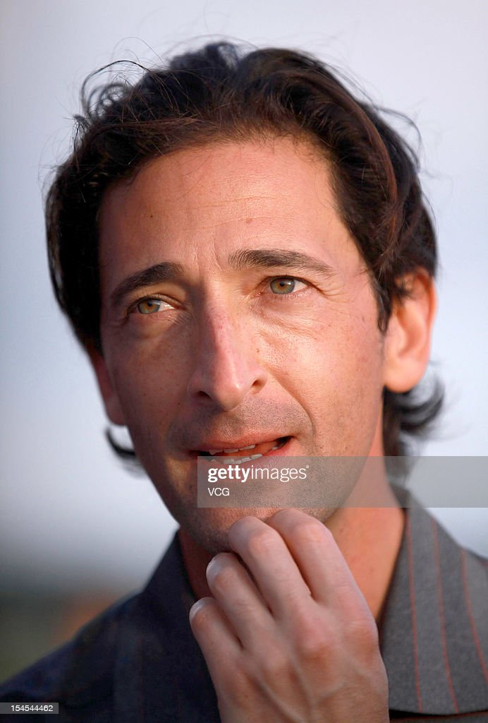 Actor <a gi-track='captionPersonalityLinkClicked' href=/galleries/search?phrase=Adrien+Brody&family=editorial&specificpeople=202175 ng-click='$event.stopPropagation()'>Adrien Brody</a> in action during day four of the Mission Hills Star Trophy at the Mission Hills Golf Club on October 21, 2012 in Haikou, China.