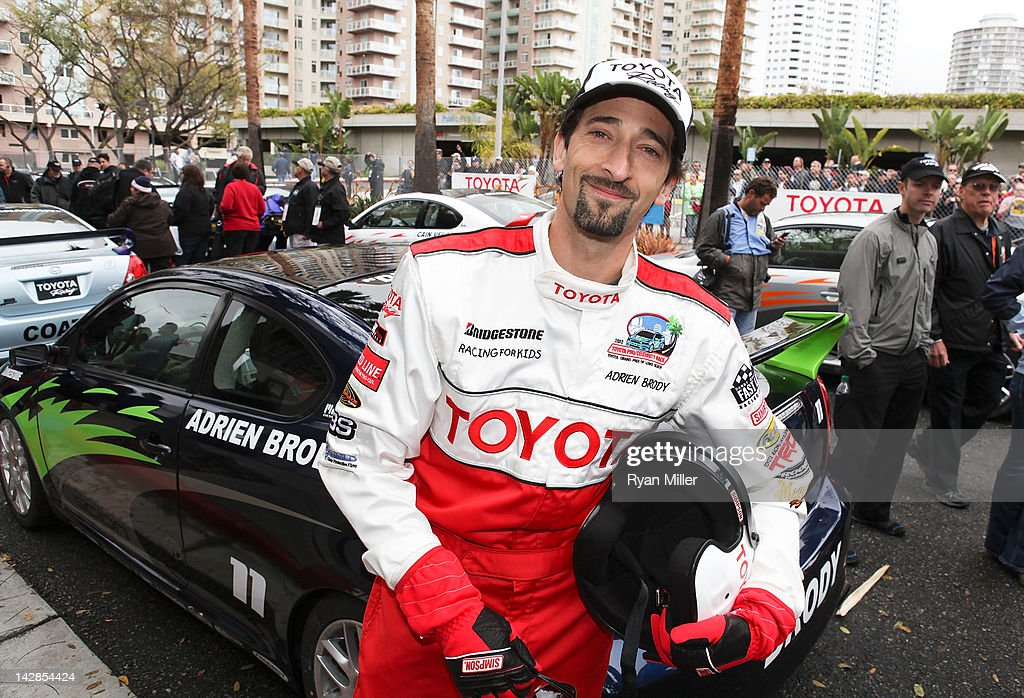 Actor <a gi-track='captionPersonalityLinkClicked' href=/galleries/search?phrase=Adrien+Brody&family=editorial&specificpeople=202175 ng-click='$event.stopPropagation()'>Adrien Brody</a> poses during the 36th Annual Toyota Pro/Celebrity Race - Press Practice Day of the Toyota Grand Prix of Long Beach on April 13, 2012 in Long Beach, California.