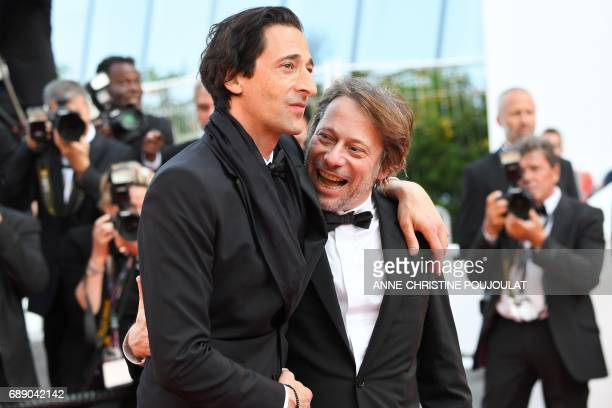 US actor Adrien Brody poses on May 27 2017 with French director Mathieu Amalric as he arrives for the screening of the film 'Based on a True Story'...