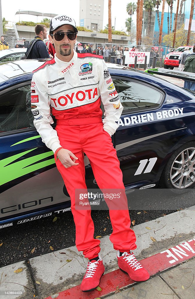 Actor <a gi-track='captionPersonalityLinkClicked' href=/galleries/search?phrase=Adrien+Brody&family=editorial&specificpeople=202175 ng-click='$event.stopPropagation()'>Adrien Brody</a> poses with his car during the 36th Annual Toyota Pro/Celebrity Race - Press Practice Day of the Toyota Grand Prix of Long Beach on April 13, 2012 in Long Beach, California.