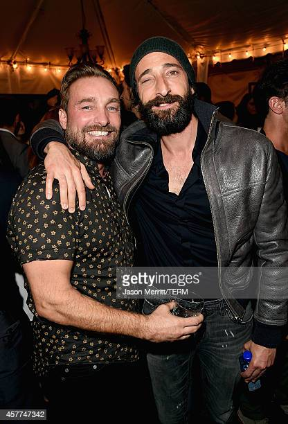 Actor Adrien Brody poses with photographer Brian Bowen Smith at the Brian Bowen Smith WILDLIFE show hosted by Casamigos Tequila at De Re Gallery on...