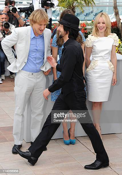 Actor Adrien Brody walks in front of actors Owen Wilson Lea Seydoux and Rachel McAdams at the 'Midnight In Paris' Photocall at the Palais des...