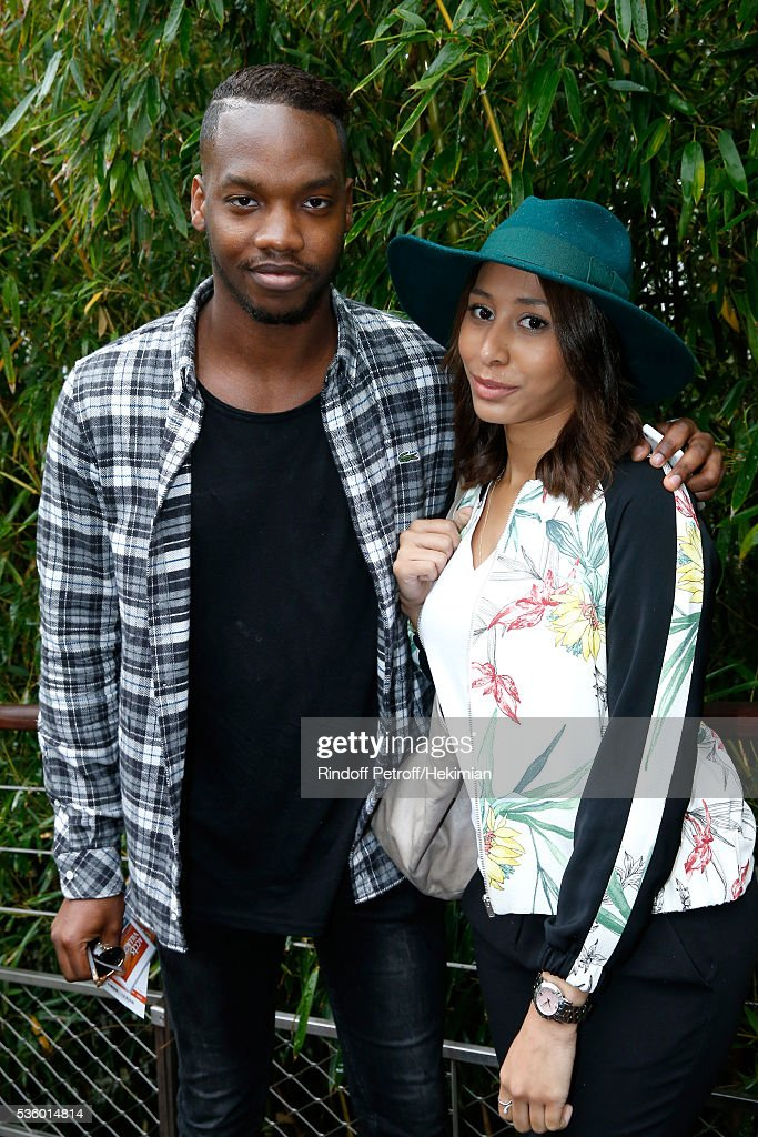 Actor Ahmed Drame and Eva attend Day Ten of the 2016 French Tennis Open at Roland Garros on May 31, 2016 in Paris, France.
