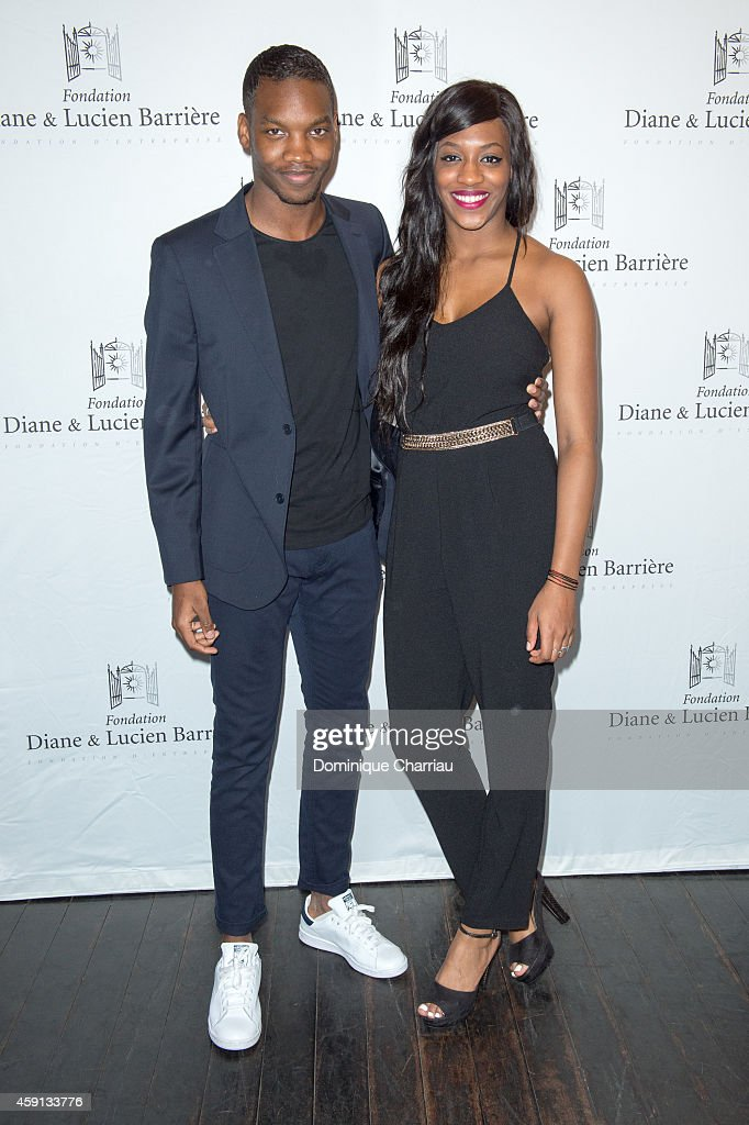 Actor Ahmed Drame and his sister actress Koro Drame attend 'Les Heritiers' Premiere Hosted by Fondation Diane & Lucien Barriere at Publicis Champs Elysees on November 17, 2014 in Paris, France.