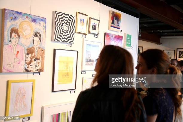 Actor Ahna O'Reilly views art at the 3rd Annual UNICEF NextGen art party at 800Main on March 11 2017 in Venice California