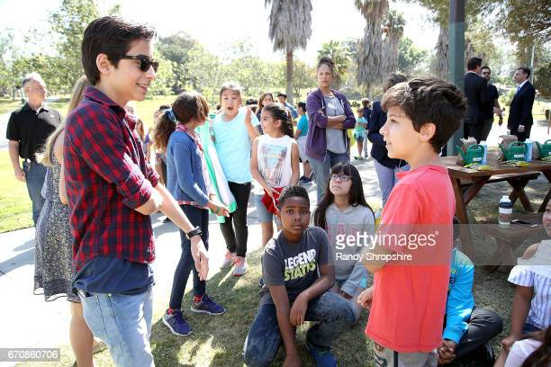 Actor Aidan Gallagher and Hancock Park Elementary School students attend Caruso hosts a community garden in honor of Earth Day in partnership with...